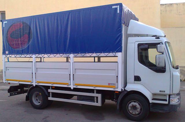Toldos para camion lonas correderas con gomas lonas for Tensores para toldos